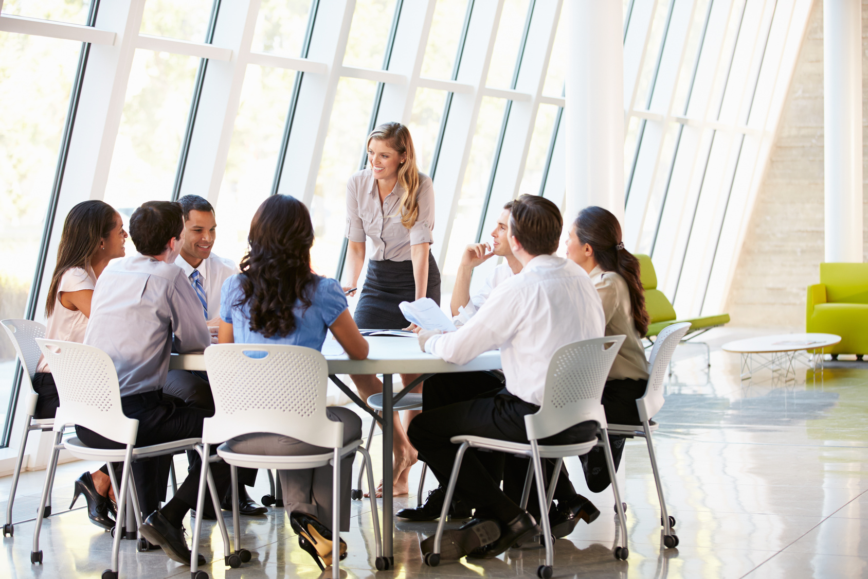 Employees hold a meeting, showing why English is important for business